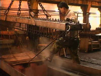 Screen shot of copper medling plant workers