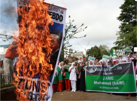 Protesters in the Philippines burn a Charlie Hebdo poster