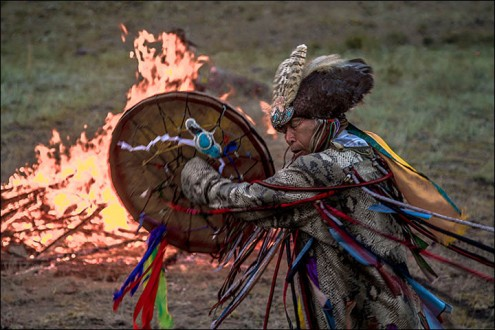 A shaman dances and drums during the 'Call of 13 Shamans' festival held in the Tyva republic (South Siberia). © Alexander Nikolsky / The Siberian Times