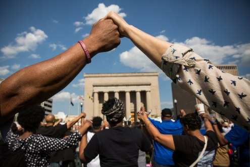 Demonstrators holding hands on May 3, 2015 in Baltimore. Image ©Andrew Burton/Getty Images via Buzzfeed