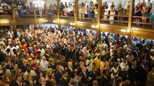 June, 18: Parishioners applaud during a memorial service commemorating the Charleston church massacre. ©David Goldman/AP