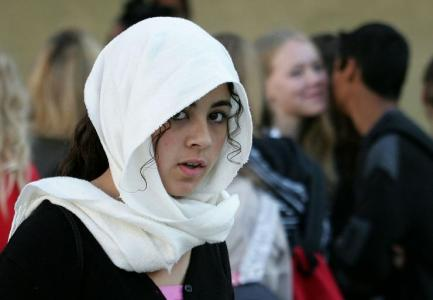A French girl wearing a hijab at school in 2004. Image © Reuters/ Pascal Rossignol via IBT