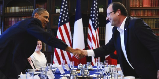 Barack Obama and François Hollande shake hands. Image © JEWEL SAMAD/AFP/Getty Images