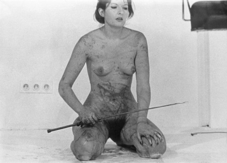 In her 1975 performance entitled LIPS OF THOMAS, Abramović cut a five-pointed star in her stomach with a razor blade, after having eaten 1 kilo of honey and drank 1 liter of wine. She continued the performance by whipping herself and eventually lying on a cross made of ice until the public couldn't stand it anymore and took her away from the scene. ©Marina Abramović